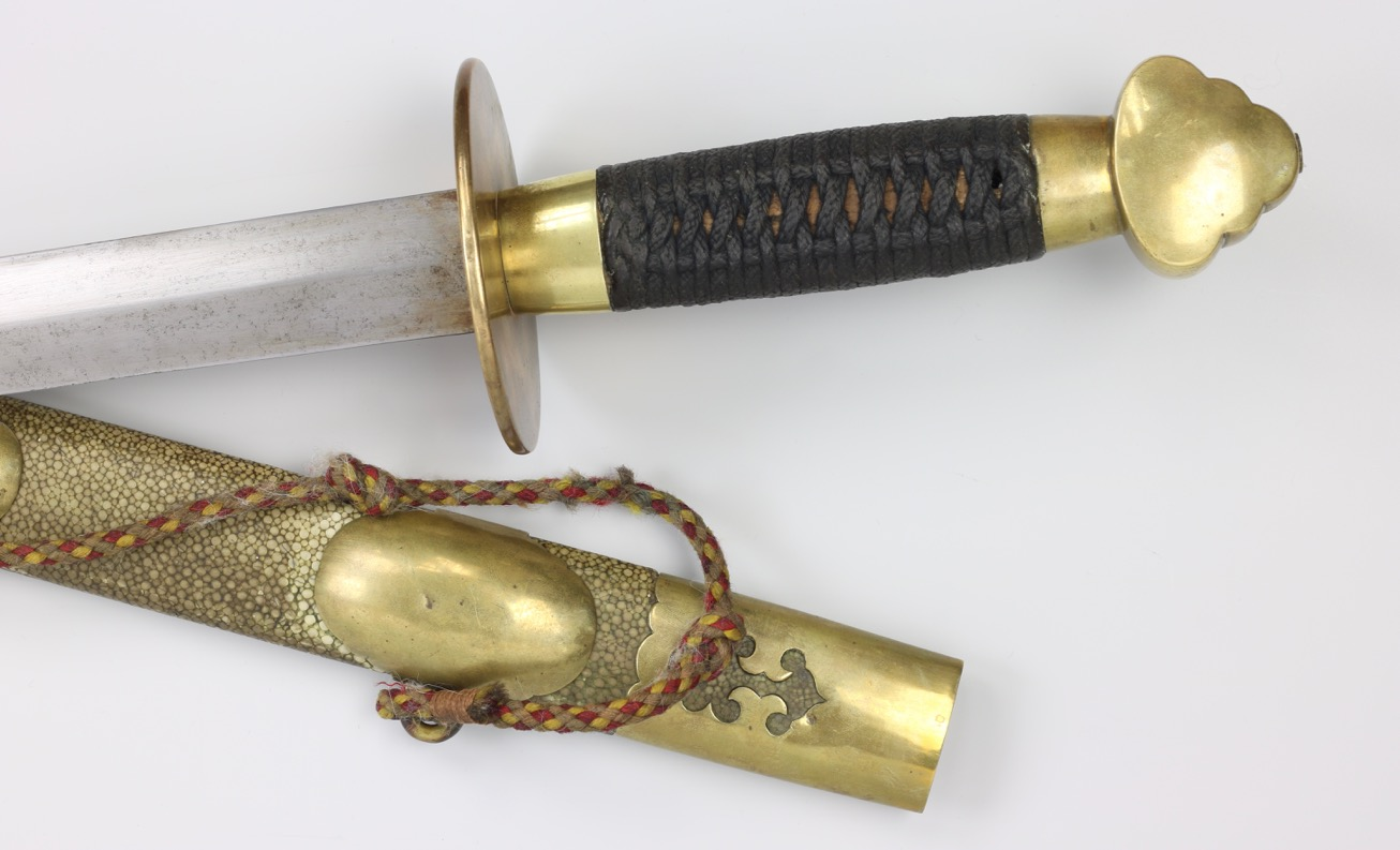 Antique Chinese straightsword with saber style guard.