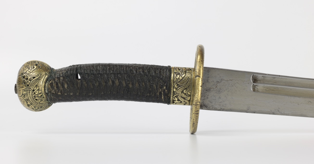 A Chinese saber with horse-tooth patterned blade. www.mandarinmansion.com