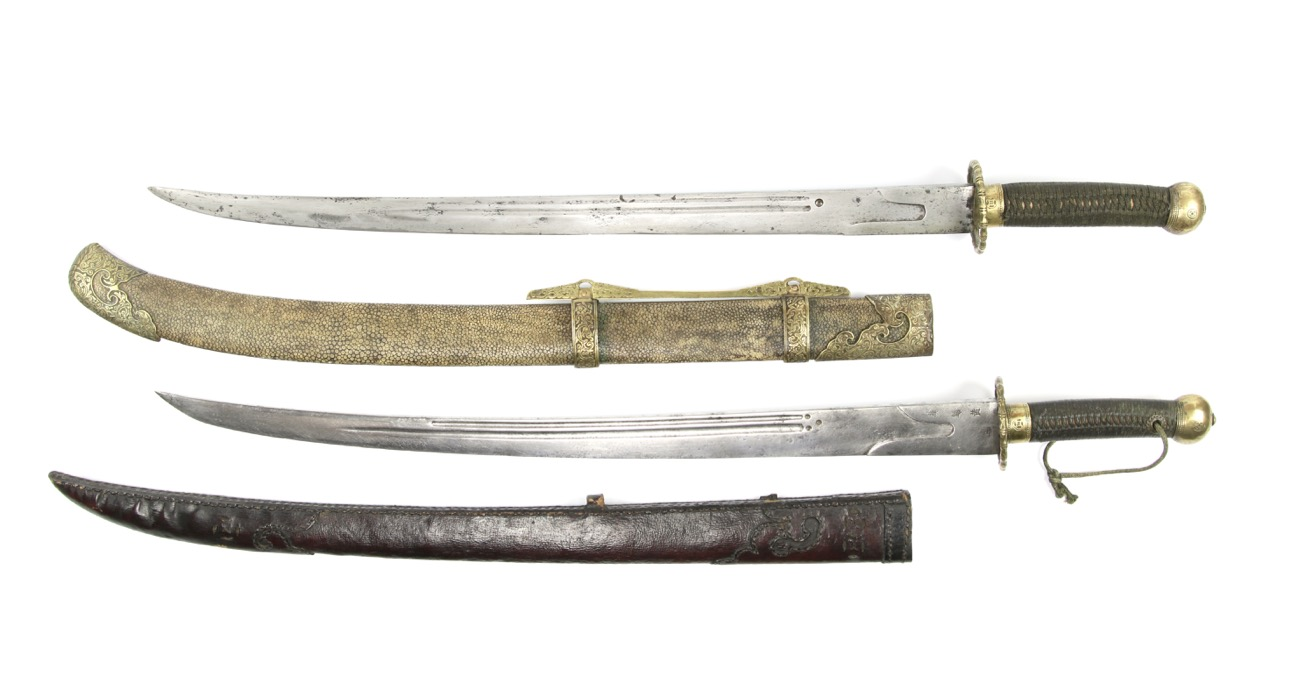 A comparison of southern Chinese Hanjun Banner sabers.
