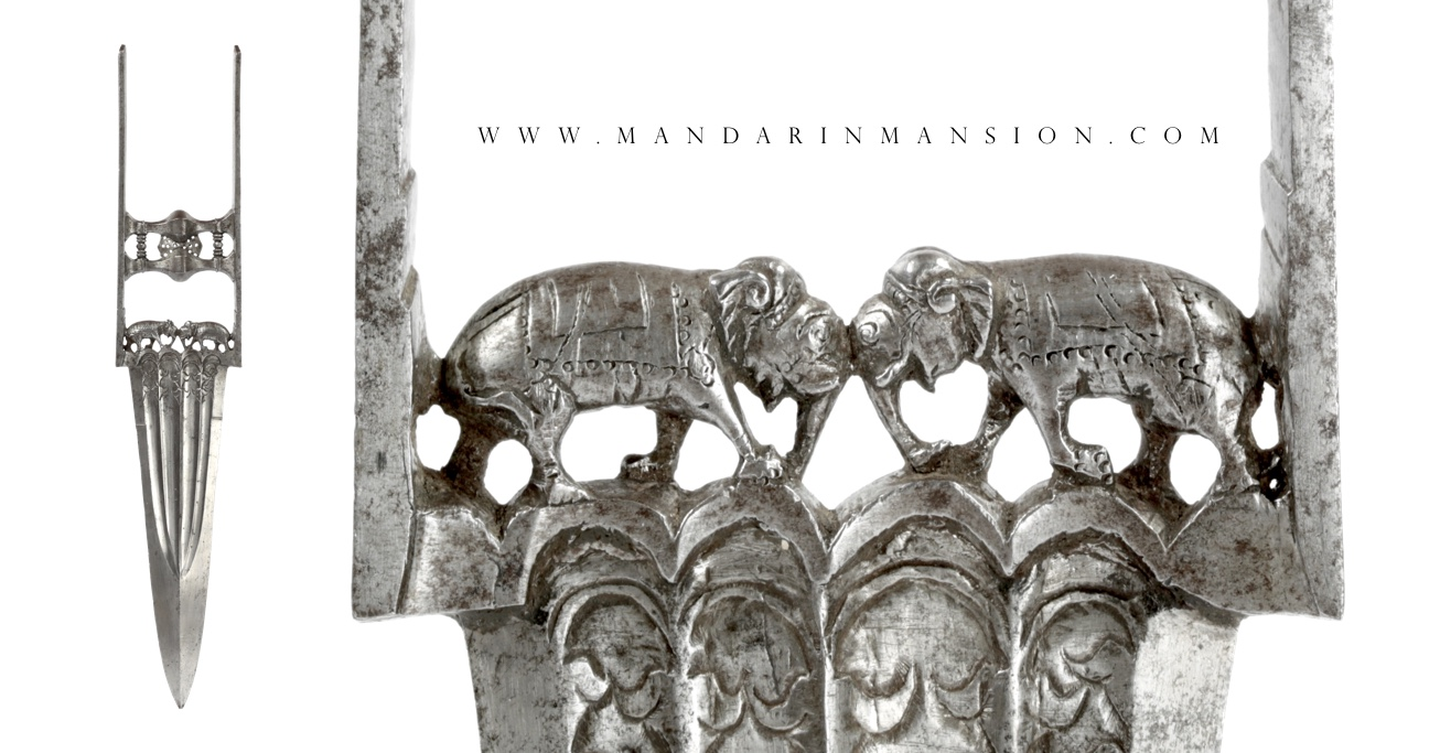 An all-steel katar with chiseled elephants and Bikaner armory marks