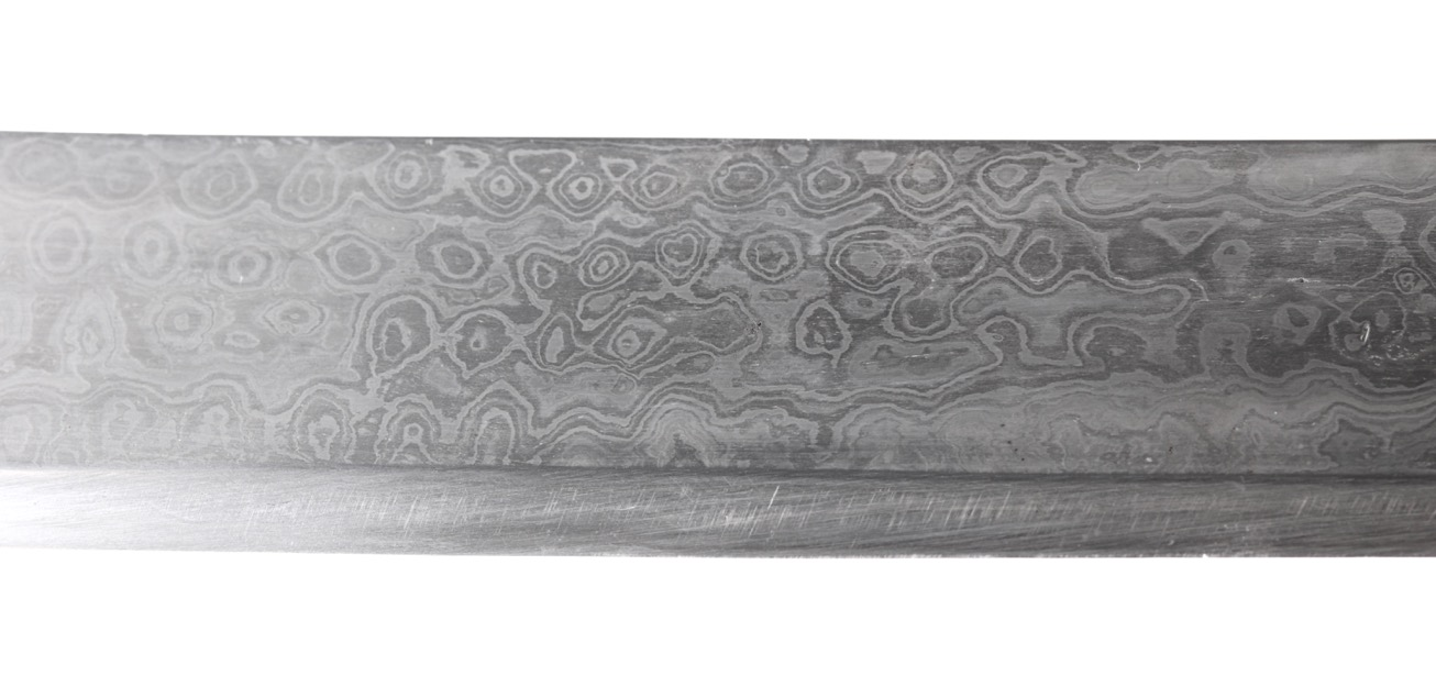 Antique Indian talwar. A heavy Indian talwar with wootz hilt elaborately decorated with gold koftgari. Its blade of mechanical damascus steel.