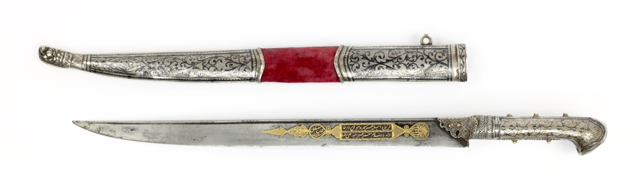 An Ottoman bichaq knife with golden damascened blade and silver-niello mounts. It was made by Mustafa in 1873 and intended for a certain Ali Riza.